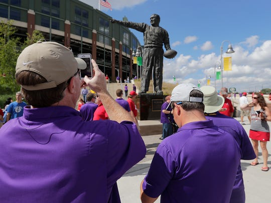 Louisiana State University fans shoot photos of the Curly Lambeau statue at Lambeau Field before the UW-LSU game September 3, 2016.