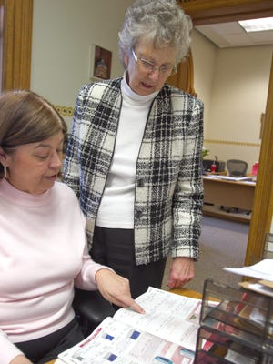 Livingston County Clerk Margaret Dunleavy, right, discusses supply purchases with administrative coordinator Debbie Warden on Dunleavy's last day in office.