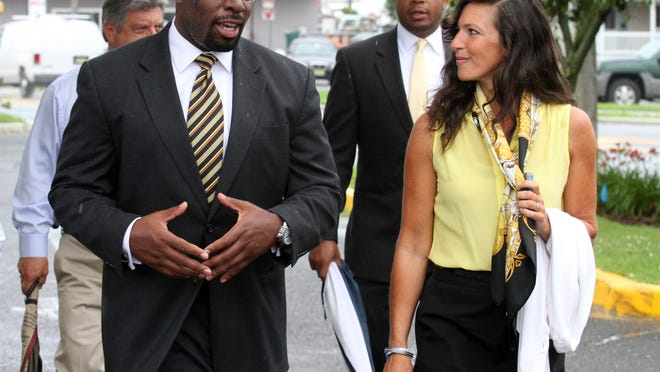 Richard Constable III, commissioner of the New Jersey Department of Community Affairs, walks with Sea Bright Mayor Dina Long during a July 2013 tour of the superstorm Sandy damaged community. Gov. Chris Christie's office announced that Constable is resigning his position at the end of the month.