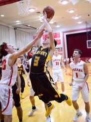 Old Fort's AJ Steyer tries to score as SJCC's Spencer Harrison defends Friday.