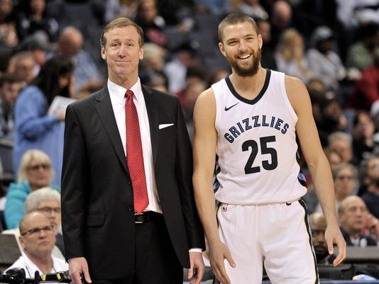 Portland Trail Blazers head coach Terry Stotts, left, and Memphis Grizzlies forward Chandler Parsons (25) talk on the sideline in the second half of an NBA basketball game Wednesday, March 28, 2018, in Memphis, Tenn. (AP Photo/Brandon Dill)