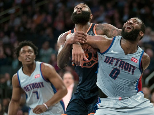 Detroit Pistons center Andre Drummond (0) and New York Knicks center Kyle O'Quinn, center, fight for position during a free throw during the second half of an NBA basketball game, Saturday, March 31, 2018, at Madison Square Garden in New York.
