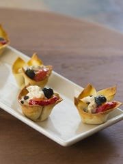 Fresh fruit tartlets (made with wonton wrappers) with chocolate chip, mascarpone and apricot glaze.