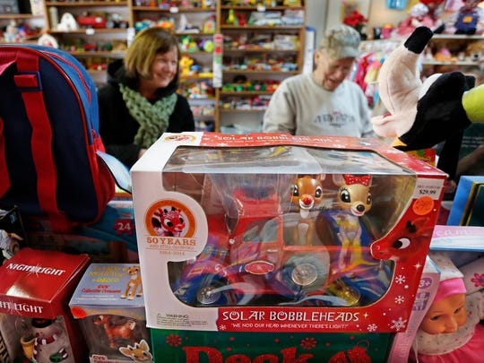 Lee and Jolinda Brunton, background, look over the toys for sale Tuesday, December 20, 2016, at the Romney Toy Shop. Since 2001, owner Terri Barnes has given new life to a variety of older, gently used toys and collectibles.