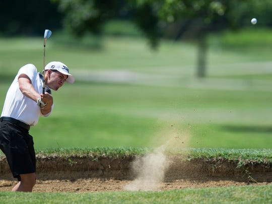 North's James Hevron chips from the bunker during the SIAC golf tournament last month. The Huskies finished fourth at state.