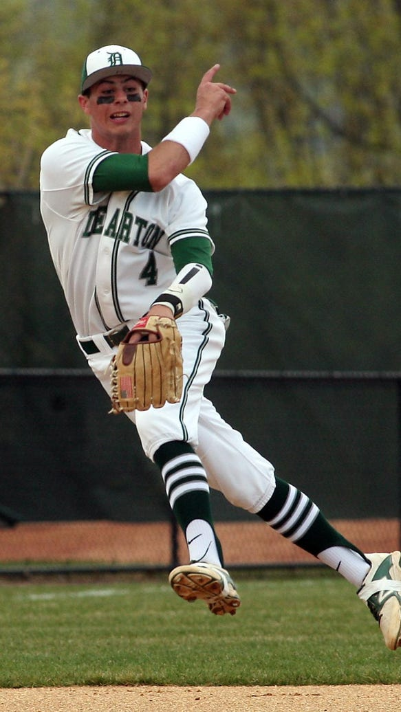 Delbarton shortstop Andrew Papantonis throws to first