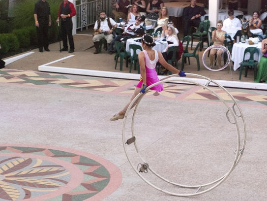Entertainment at the annual Midsummer Masquerade comes