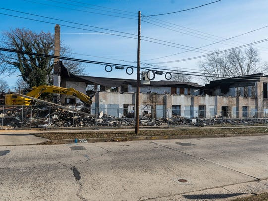 Demolition work at 702 E. Quince St, a former clothing