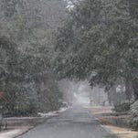 Snow falls on Island Drive. Monroe is covered in a blanket of white on Wednesday as snow falls across northeastern Louisiana.