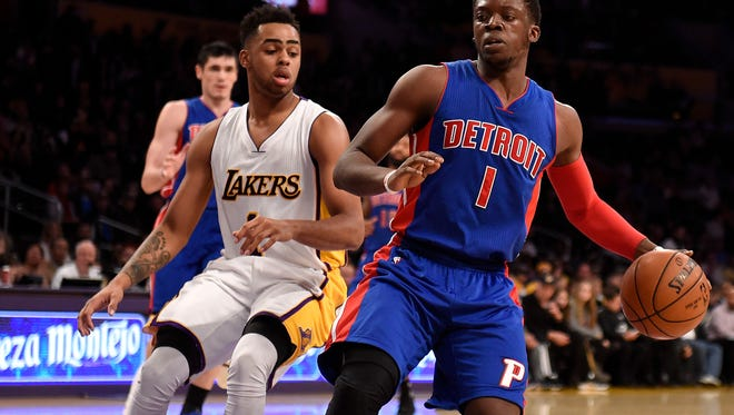 Pistons guard Reggie Jackson handles the ball against Lakers guard D'Angelo Russell during the Pistons' loss Sunday at Staples Center.