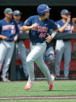 Arizona's JJ Matijevic (24) watches the ball land in center field while running to home plate during an NCAA college baseball regional game against Delaware, Saturday, June 3, 2017, in Lubbock, Texas. (Brad Tollefson/Lubbock Avalanche-Journal via AP)