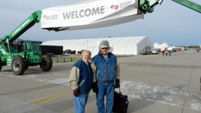 Bob and Susan Manzke are all smiles on opening day of the WPS Farm Show in Oshkosh.