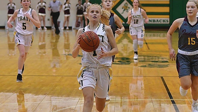 Junior Sian Helfrich eyes the basket to score against the Hays Indians on Tuesday, Jan. 7 in the Pratt High School gym.
