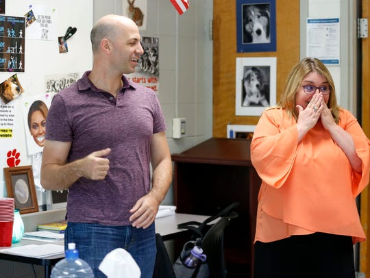 Ozark Junior High School teacher Natalie Houston reacts with excitement and shock after being surprised by one of her favorite playwrights, Don Zolidis, in her class on Wednesday