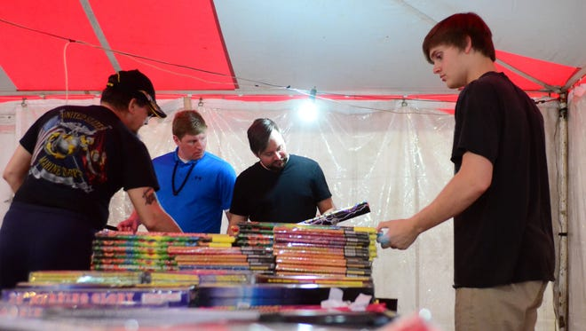Chris Cothern of Hattiesburg looks at fireworks Tuesday at the Pine Belt Fireworks stand on Old Highway 11.