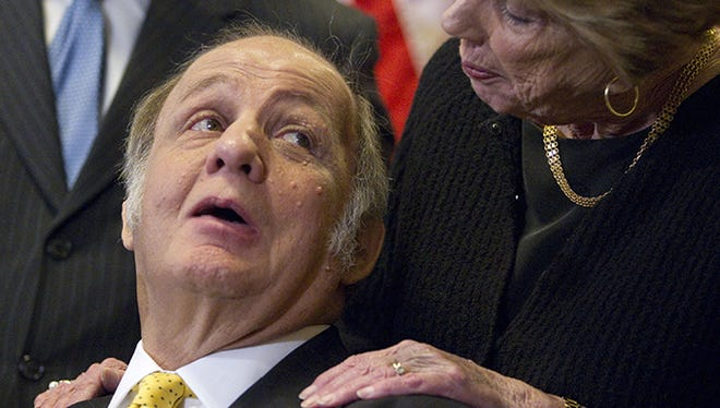 Evan Vucci,  AP Former White House press secretary James Brady, left, who was left paralyzed in the Reagan assassination attempt, looks at his wife Sarah Brady, during a news conference on Capitol Hill in Washington, Wednesday, march 30, 2011, marking the 30th anniversary of the shooting.