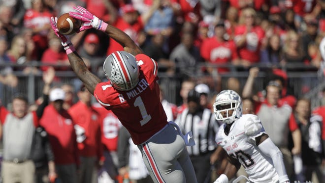 Ohio State receiver Braxton Miller, left, catches a pass in front of Maryland defensive back Anthony Nixon during the second quarter of an NCAA college football game Saturday, Oct. 10, 2015, in Columbus. (AP Photo/Jay LaPrete)
