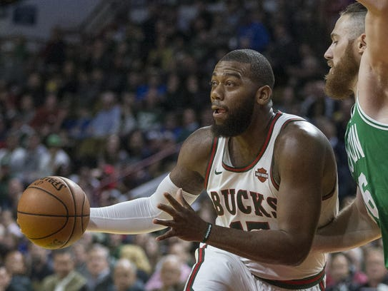 Greg Monroe (left) was recently traded to the Phoenix