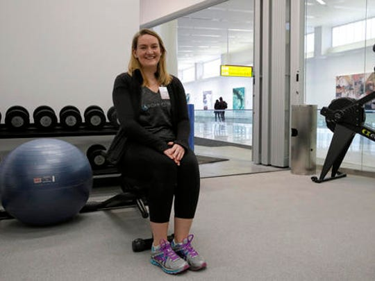 In this Jan. 30, 2017 photo, ROAM Fitness CEO Cynthia Sandall poses inside the soon-to-be-open ROAM Fitness gym at Baltimore-Washington International Thurgood Marshall Airport in Linthicum, Md. Working out while waiting for your flight will soon be an option at BWI, where the only gym at a U.S. airport past security will open this week, with plans for 20 more at airports by 2020.