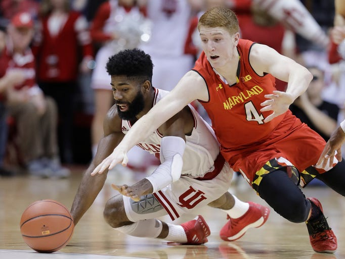 Indiana's Robert Johnson and Maryland's Kevin Huerter