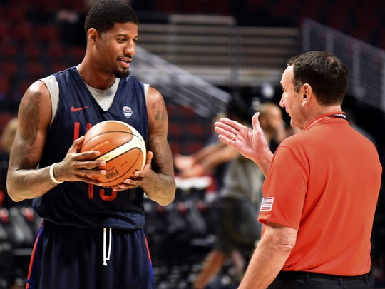 Jul 28, 2016; Chicago, IL, USA; USA guard Paul George (13) talks with USA head coach Mike Krzyzewski during practice at  the United Center. Mandatory Credit: David Banks-USA TODAY Sports