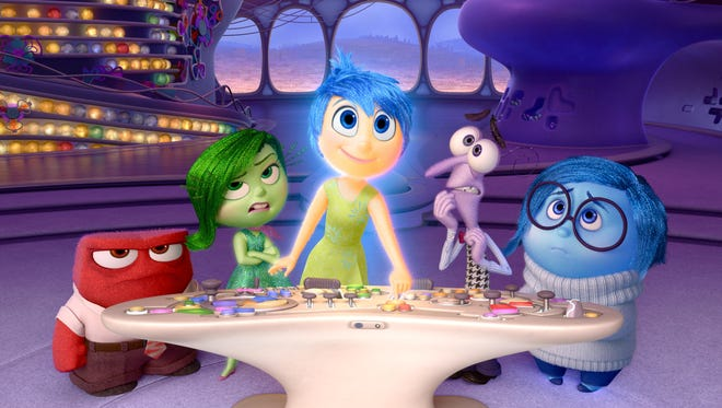 "Anger (voiced by Lewis Black), Disgust (Mindy Kaling), Joy (Amy Poehler), Fear (Bill Hader) and Sadness (Phyllis Smith), from left, appear in ""Inside Out."""