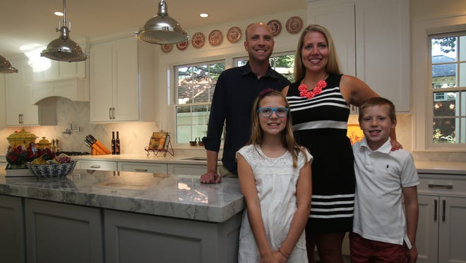Jason Gnagy, his wife Amy Gnagy and their kids, Ava, 10, and Jack, 8 are photographed in their new home in New Rochelle July 29, 2016.