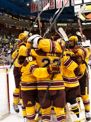 Minnesota players celebrate after an NCAA college hockey game against Michigan in the Big Ten Conference tournament Saturday, March 21, 2015, in Detroit. Minnesota defeated Michigan 4-2 to win the Big Ten Championship tournament.