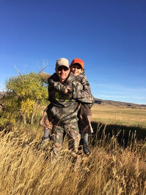 Ed Sweeny carries son, Ford, during an Outdoor Dream Foundation adventure in Wyoming.