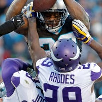 Stewart runs for 3 TDs, Panthers beat Vikings 31-24