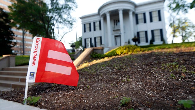 A small Human Rights Campaign equality banner flies on the grounds of the Governor's Mansion in Jackson.