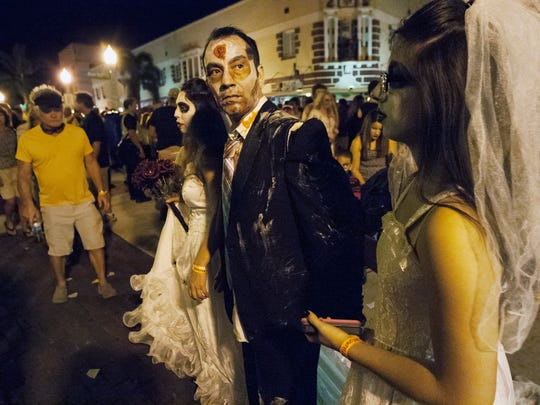 Thousands of people dressed as zombies filled the streets