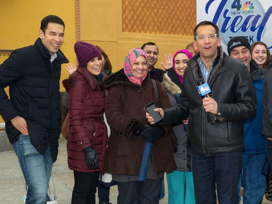 The NBC 4 Treat Truck   and News 4 Team Stefan Holt, Natalie Pasquarella and Weatherman Dave Price greet residents and distribute snacks and goodies at the Westfield Garden State Plaza.