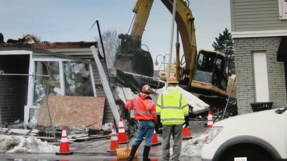 Two buildings were demolished at Penfield's Four Corners to make room for an expanded Mark's Pizzeria.
