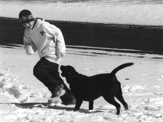 Chase Edwards and his chocolate Lab, Frank, in 2003.