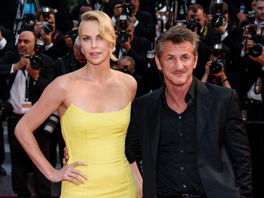 A couple at Cannes last year, director Sean Penn (right)