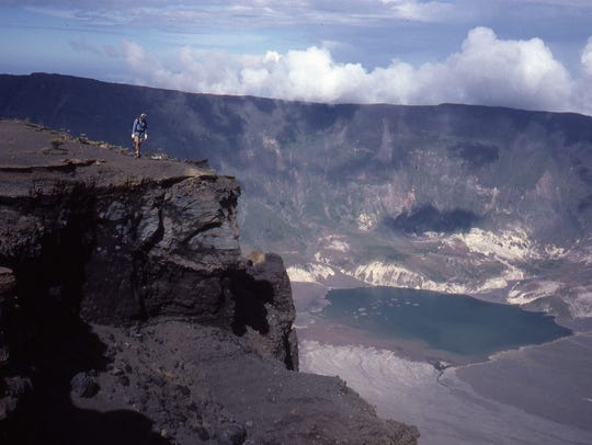 Sulphuric gases rise from the crater of Mt. Tambora