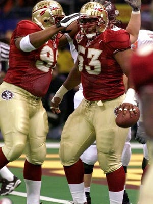 Florida State nose guard Corey Simon (right) is congratulated by teammate Jerry Johnson after recovering a fumble by Virginia Tech quarterback Michael Vick during the Sugar Bowl on Tuesday, Jan. 4, 2000 in New Orleans.