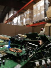 Greenboards and other electronic components fill the warehouse at NewHope Industries, as part of their eRecycling program.