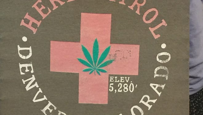 Explicitly marijuana-themed T-shirts like this one displayed in a Denver souvenir store window are now banned from sale at Denver International Airport.