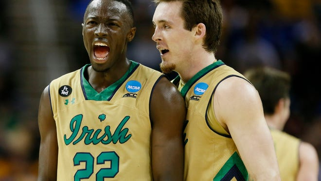 Notre Dame Fighting Irish guard Jerian Grant (22) and guard/forward Pat Connaughton (24) react during the Sweet 16. They will take on No. 1 Kentucky on Saturday night.