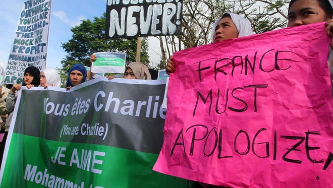 "Filipino Muslim students, religious and community leaders protest against ""Charlie Hebdo"" in Marawi City on Wednesday."