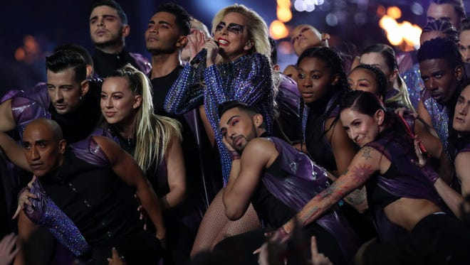 Imaginative pop star Lady Gaga played it safe at the Super Bowl halftime show Sunday.