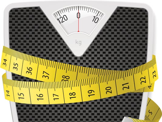 Tape measure wrapped around house scale
