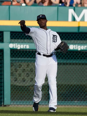 Tigers leftfielder Justin Upton (8) makes a throw during the first inning on Friday, July 14, 2017, at Comerica Park.