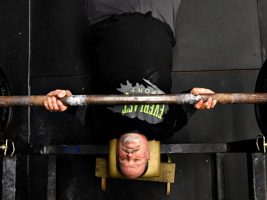 Mark Duckworth, of Fawn Township, bench presses 45-pound plates on a 33-pound bar during open gym at McKenna's Gym in Fawn Grove, Pa. on Thursday, Nov. 5, 2015. Dawn J. Sagert - dsagert@yorkdispatch.com