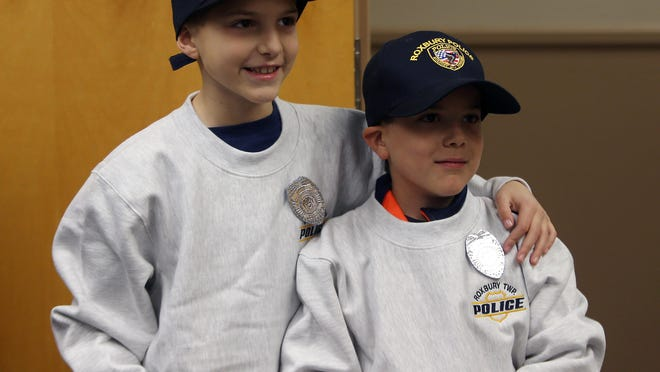 James, 8, and Thomas DeChristofano, 6, of Roxbury won a chance to ride with Roxbury police and pulling over two Detectives, issuing them a warning for not wearing a seatbelt.