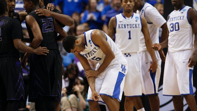 Kentucky's Andrew Harrison hurt is arm late in the second half against Kansas State in the NCAA tournament Midwest second round in St. Louis, Mo. Cats won 55-49. March 21, 2014
