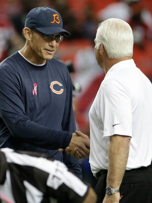 Former Bears coach Marc Trestman, left, and former Falcons coach Mike Smith lost their jobs Monday.