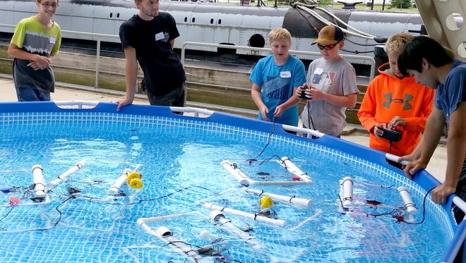 Students test their underwater robots during an underwater robotics summer camp at Manitowoc's Wisconsin Maritime Museum.